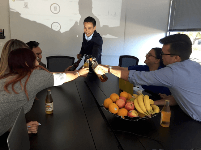 toasting beers during meeting in conference room