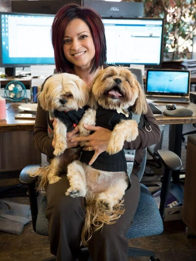 SnackNation-Office-Woman-Holding-Dogs